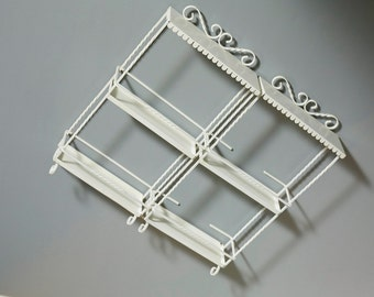 2 pretty metal shelves, wall decoration in offwhite, side twisted metal