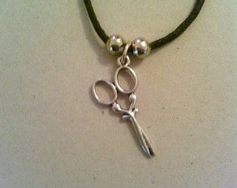Silver coloured Scissors with leather necklace