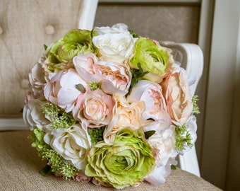 Ivory, cream, blush pink and green silk wedding bouquet. Made with artificial roses, peonies, and ranunculus.