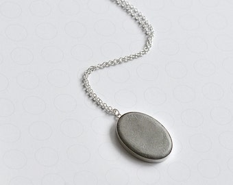 statement necklace with oval concrete pendant