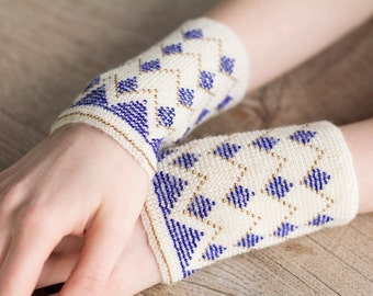 Hand-knitted white color wrist warmers decorated with white/blue/green/gold beads