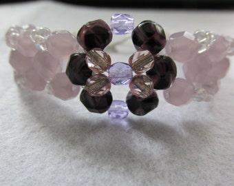 Handmade purple and white beaded bracelet