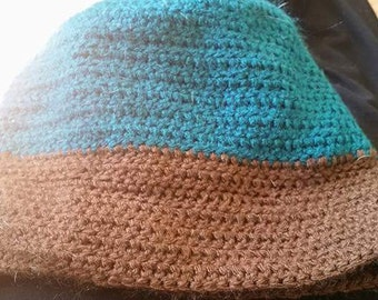 Teal and brown hat
