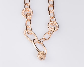 Golden tone oval link  with CZ accented ball bracelet