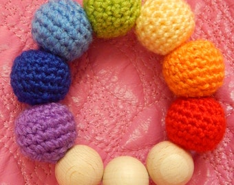Chewing ring ''rainbow'' with crochet balls for babies. A nice gift for baby.