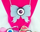 Kawaii Eyeball Bow Laser Cut Necklace - Creepy Cute/Pastel Goth Inspired Statement Jewelry