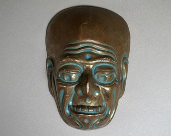 Antique Clay Grotesque Mask