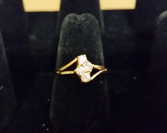 Gold tone ring with cubic zirconia,