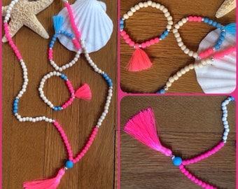 Jewelry set, tassel necklace neon pink, blue and light wood beads.  Matching tassel bracelets