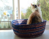 Cuddly cat snuggle bed - blue and orange