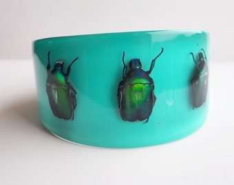 Large blue lucite bracelet with real metallic insects