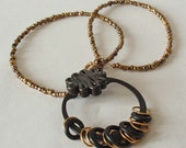 Black Gold Necklace: pendant hardware polymer clay beaded bronze squiggle circle hoops