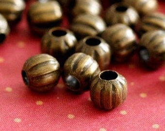 100pcs Antique Brass Watermelon Round Spacer Beads 4mm E185Y-AB