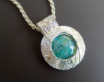 Unique One-of-a-Kind Tribal Domed Silver Pendant Necklace with Encased Aqua Dichroic Glass Cabochon on 18 inch sterling silver Rolo Chain
