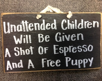 Unattended children given espresso and free puppy sign wood