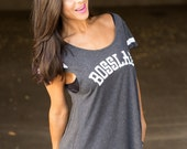 Bosslady.  Wide Shouldered Flutter Sleeve Flowy Muscle Tee.  Sport Striped Off Shoulder Tee.  Attitude Tee.  Sporty Tee.  USA Made.