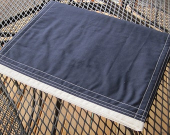 Laptop computer case/sleeve in navy fabric with off-white trim, padded, tailored.