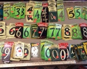 """385 vintage numbers, assorted numbers, about 4"""" high etc....  Some are plastic, some metal and some are solid brass."""