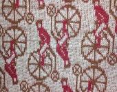 vintage 1960s 70s antique novelty print man on bicycle boneshaker knit t shirt fabric