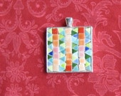 Mosaic Quilt. Tiny Tiles. Pendant. Monochromatic Colors. Pastel Colors. Mosaic Pendant. Silver Colored Frame. Just over 1 inch Square.