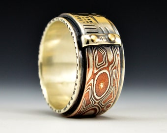 Balance Series - Trade Off.  Mokume and Hand-stamped Silver with Gold Rivets Ring