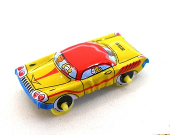 Lil Tin TOY Car, yellow, red & blue, 1960s Japan. Tin lithograph.