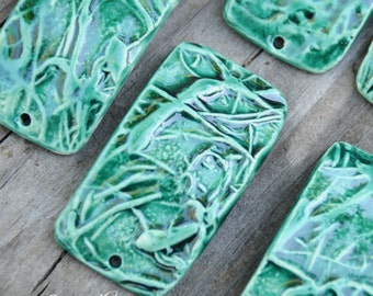 Pottery Bracelet Bead in Emerald Green with design of vines