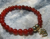 Carnelian Mala Bracelet prayer beads (Buddhist rosary) with Gold Om (Aum) - 27 beads - Red