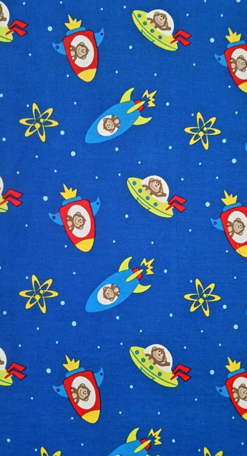 Cotton fabric astromonkey toss rocket ships monkeys deep blue for Rocket fabric