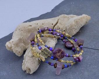 Another purple tiger ..... an adjustable wrap bracelet made with genuine amethyst purple Maine sea/beach glass and  purple impression jasper
