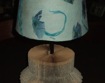 Lamp with folded book