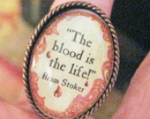 """BRAM STOKER GOTHIC Quotation Ring, """"The Blood is the Life"""", top quality adjustable coppertone ring base, oval image under glass"""