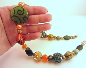 One of a kind olive and orange beaded necklace. Mixture of acrylic beads, statement jewelry. Bright and original, gold pearls. Bold.