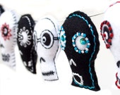 Halloween garland decoration, contemporary folk art, black and white embroidered felt skulls