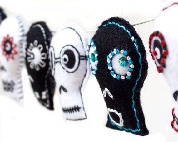 Halloween garland decoration, contemporary folk art, black and white embroidered felt skulls