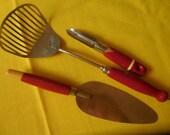 Three Red Wooden Handled Kitchen Utensils