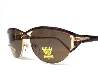 vintage 1990's NOS tortoise shell gold metal sunglasses womens fashion accessories accessory sun glasses retro modern new cat eye open cross