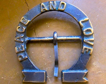 1960s Hippie Buckle Bronze Tone Metal Lucky Horseshoe Stamped Peace And Love Sixties Music Festival Costuming Fashion Kitsch