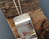 Sterling silver handmade embossed dandelion necklace, with hand pierced butterfly. Hallmarked