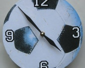 Wood wall clock. Image of a soccer ball.  For soccer fans everywhere.