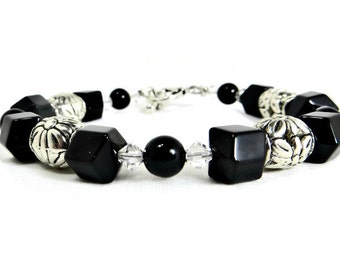 Black Onyx Faceted and Round Beads, Pewter Flower Drum Beads, & Clear Swarovski Crystals Bracelet