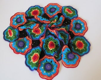 Lovely crocheted soft and warm scarf in coloured and black patterns, granny squares, hippie, retro, kaleidoscope flowers shades