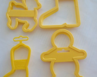 Four Yellow Wilton Cookie Cutters: Reindeer, Santa Boot, Boy, Cowboy Boot
