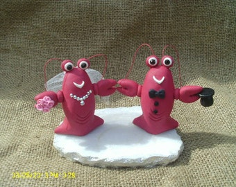 Lobster bride and groom wedding cake topper