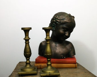 Vintage solid brass candlesticks with screw off bases
