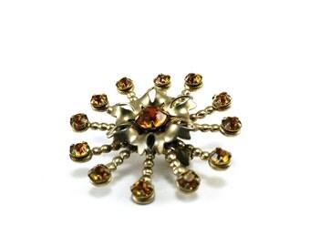 Amber rhinestone brooch - starburst design
