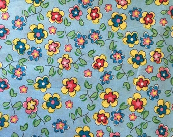 Ditsy flowers blue cotton fabric by the half metre
