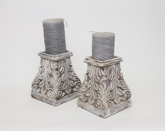 Two candles with distressed candle holders