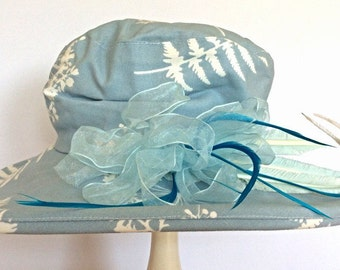 Blue and white summer hat with feather trim OOAK