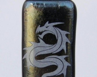 white enamel dragon on special black glass pendant.